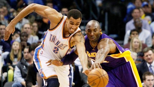 Oklahoma City Thunder guard Thabo Sefolosha of Switzerland battles for a loose ball with Los Angeles Lakers guard Kobe Bryant (Reuters)