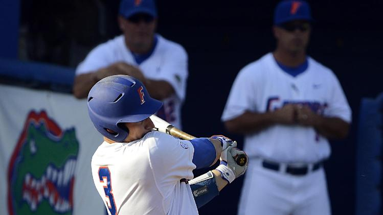 Florida's Mike Zunino (3) hits a three-run home run in the second inning during an NCAA college baseball tournament regional game against Georgia Tech in Gainesville, Fla., Sunday, June 3, 2012. Florida won 15-3. (AP Photo/Phil Sandlin)