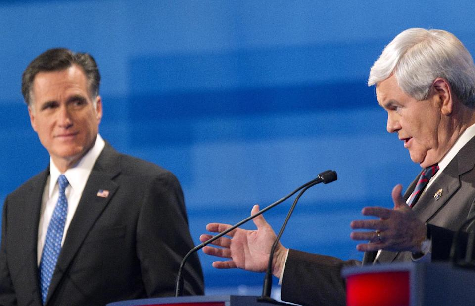 Republican presidential candidate former House Speaker Newt Gingrich, right, speaks during the South Carolina Republican presidential candidate debate as former Massachusetts Gov. Mitt Romney, left, listens Monday, Jan. 16, 2012, in Myrtle Beach, S.C. (AP Photo/David Goldman)