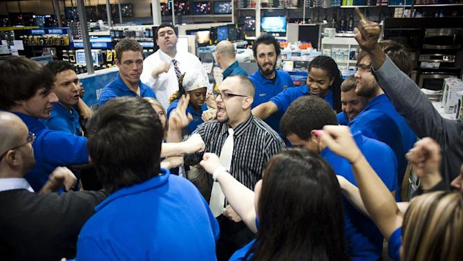 Best Buy general manager Javier Morales leads a team cheer before his store opened for the first hours of Holiday Black Friday shopping on Friday, Nov. 25, 2011 in Houma, La.  Black Friday began in earnest as stores opened their doors at midnight. (AP Photo, Michael Conti/The Houma Courier)  MAGS OUT