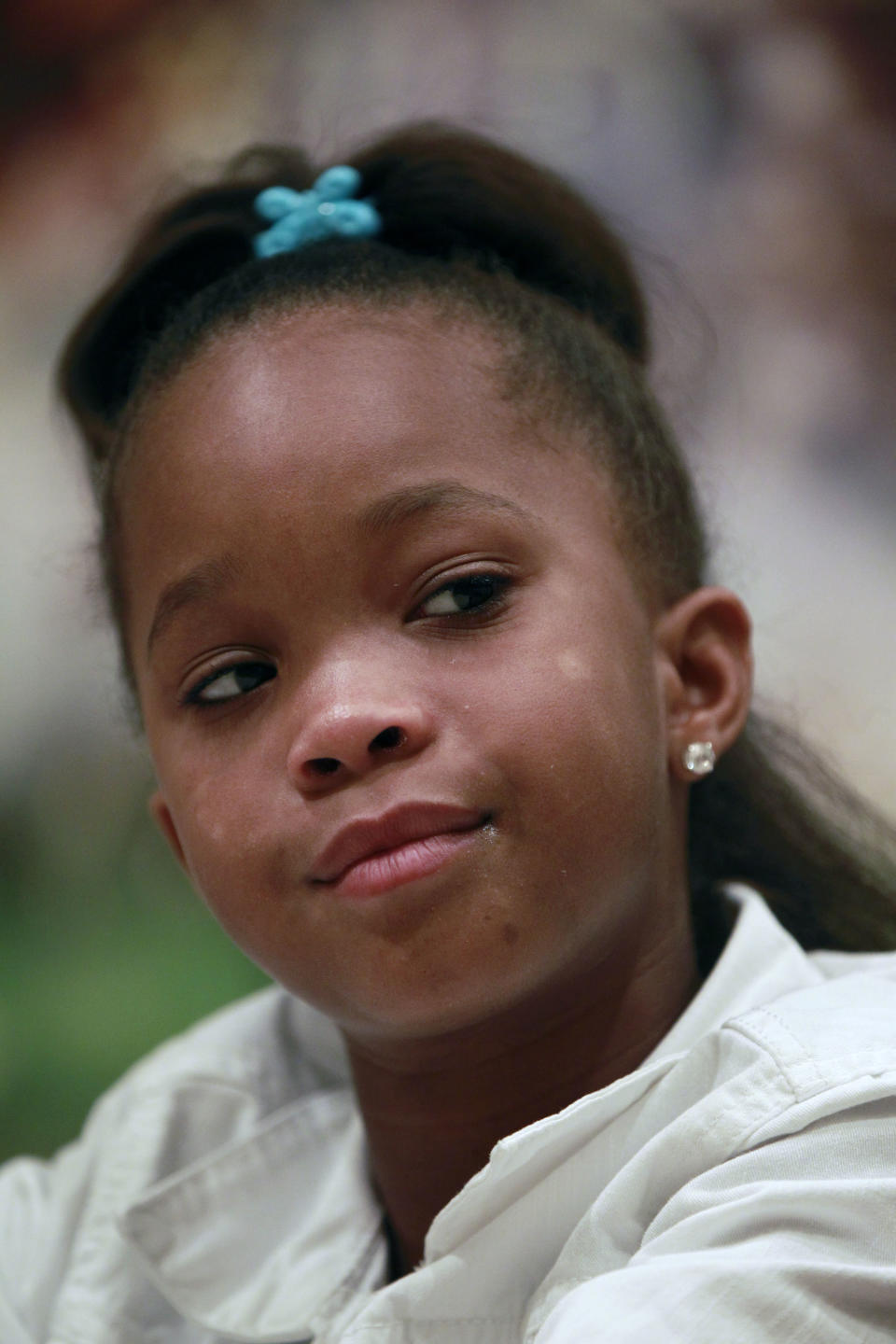 "Actress Quvenzhané Wallis who portrays the lead character Hushpuppy in the movie ""Beasts Of The Southern Wild,""  speaks during an interview in New Orleans, Monday, June 25, 2012. (AP Photo/Gerald Herbert)"