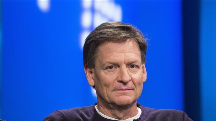 """Author Michael Lewis smiles during an interview at Reuters regarding his book about high-frequency trading (HFT) named """"Flash Boys: A Wall Street Revolt,"""" in New York"""