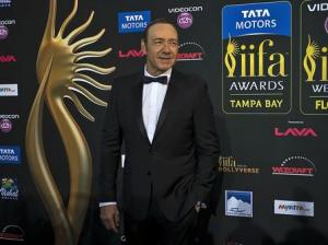 Actor Kevin Spacey walks the green carpet as he arrives for the 15th annual International Indian Film Awards in Tampa, Florida