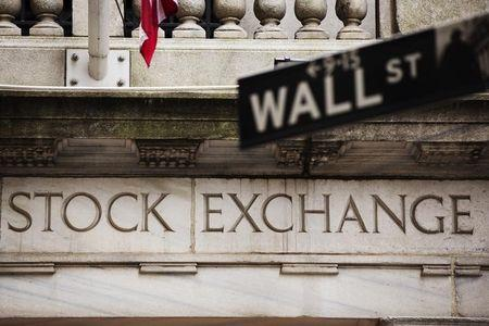 Wall Street falls on earnings, but indexes well off lows