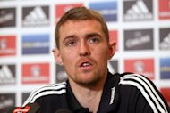 Scotland national football team player Darren Fletcher speaks during a press conference in Brussels, on the eve of his team's qualifying football match for the 2014 World Championships against Belgium