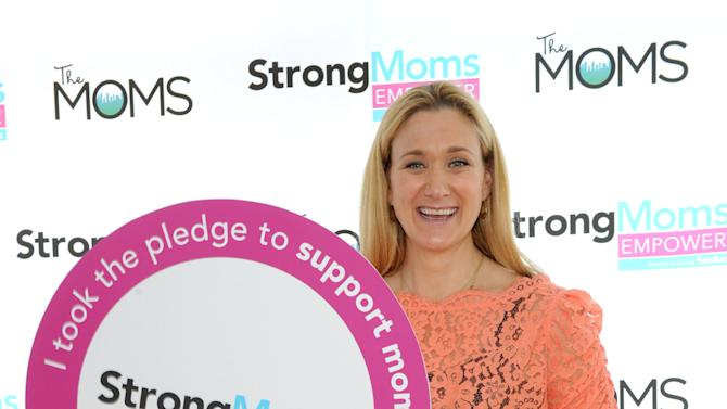 IMAGE DISTRIBUTED FOR SIMILAC - Kerri Walsh Jennings, three-time Olympic gold medalist and mom of three, shows her support for moms at the StrongMoms Empowerment Summit, hosted by Similac, Tuesday, May 7, 2013, in New York.   Visit StrongMomsEmpower.com to take the pledge and support moms. (Photo by Diane Bondareff/Invision for Similac/AP Images)