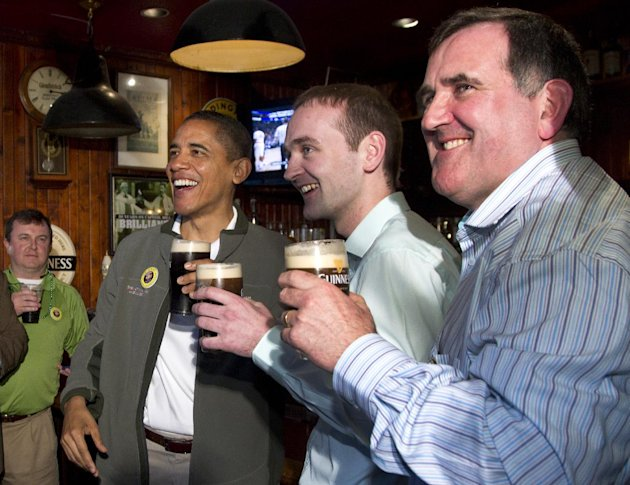 President Barack Obama drinks a Guinness with his ancestral cousin from Moneygall Ireland Henry Healy, center, and the owner of the pub in Moneygall I...