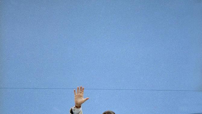 FILE - In this Feb. 19, 1992 file photo, President George H.W. Bush waves before boarding Air Force one at Andrews Air Force, Md. President Barack Obama flies Air Force One when he leaves town. So does Candidate Barack Obama. The distinction between the two roles for Obama matters because it helps determine who foots the bill for his travel. Either way, though, it's a safe bet that taxpayers are on the hook for at least part of the tab. Operating under the same rules that have governed presidential travel dating back to the Reagan years, Obama must reimburse the government for a portion of the costs associated with any political travel. But presidents of both parties have been secretive about the complicated mechanics. (AP Photo/Charles Tasnadi, File)
