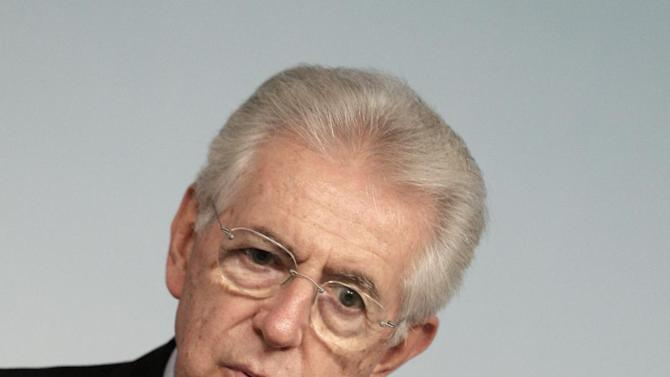 Italian Premier Mario Monti gestures during a press conference at the end of a cabinet meeting at Chigi Palace government's office in Rome, Thursday, Dec. 6, 2012. Concerns over the stability of the Italian government grew on Thursday after Silvio Berlusconi's party withdrew its support, threatening to bring a premature end to Premier Mario Monti's ambitious reforms program. Berlusconi's center-right PDL party abstained from a confidence vote in the Senate on Thursday. Though Monti's government of unelected technocrats won the vote by 127 to 17, investors fear the move heralds a period of political uncertainty in the run-up to planned elections next year. (AP Photo / Riccardo De Luca)