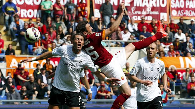 AS Roma's Vassilis Torosidis jumps for the ball against Atalanta's Guglielmo Stendardo during their Serie A soccer match in Rome