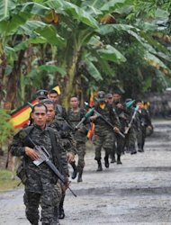 Moro Islamic Liberation Front (MILF) rebels patrol prior inside their base at Camp Darapan, Sultan Kudarat province, on the southern Philippine island of Mindanao, in 2011. The MILF is the biggest and most important remaining rebel group in the Philippines, after the Moro National Liberation Front signed a peace pact with the government in 1996