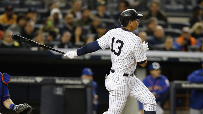 New York Yankees designated hitter Alex Rodriguez (13) hits in the fifth inning of a baseball game against the New York Mets at Yankee Stadium in New York, Sunday, April 26, 2015.  (AP Photo/Kathy Willens)