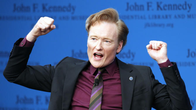 """FILE - This May 24, 2012 file photo shows late night talk show host Conan O'Brien speaking during a forum at the John F. Kennedy Presidential Library in Boston. TBS says it's extending Conan O'Brien's late-night hour through November 2015.    O'Brien premiered """"Conan"""" on TBS in November 2010, some months after his departure from a short-lived stint as host of NBC's """"Tonight"""" show. He left NBC when Jay Leno was returned as """"Tonight"""" host. Although """"Conan"""" averages just 900,000 viewers nightly, it leads the late-night pack in social media engagement and online activity, according to TBS.""""Conan,"""" hosted by O'Brien with Andy Richter as announcer, airs Monday through Thursday at 11 p.m. Eastern time. (AP Photo/Michael Dwyer, file)"""