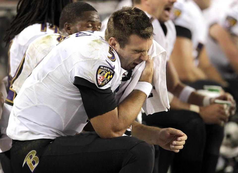 Baltimore Ravens quarterback Joe Flacco sits on the bench during the second half of an NFL football game against the Denver Broncos, Thursday, Sept. 5, 2013, in Denver. (AP Photo/Joe Mahoney)