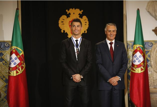 Portugal's soccer team captain Ronaldo poses with Portugal's President Cavaco Silva after receiving the Ordem do Infante Dom Henrique in Lisbon