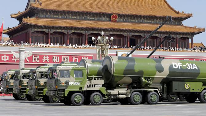 Military vehicles carrying DF-31A long-range missiles drive past the Tiananmen Gate during a military parade to mark the 70th anniversary of the end of World War Two, in Beijing
