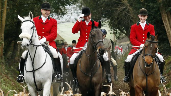 Members of the Old Surrey Burstow and West Kent Hunt ride to Chiddingstone Castle for the annual Boxing Day hunt in Chiddingstone, south east England