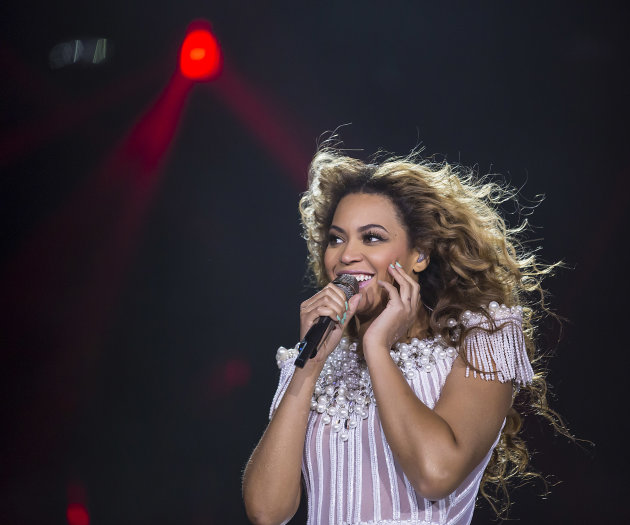 FILE - This May 17, 2013 file photo released by Parkwood Entertainment shows singer Beyonce performing during her Mrs. Carter Show World Tour 2013, in Zurich, Switzerland.  It's a crowded tour market