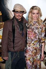 Johnny Depp y Amber Heard via WireImage