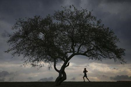 A woman is seen jogging at Cunningham Park in the borough of Queens in New York