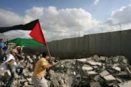 Palestinians carry their national flag towards Israel&#39;s controversial separation barrier during a rally to mark the 40th anniversary of the outbreak of the 1967 Six Day War in the northern West Bank city of Tulkarem in 2007. In 1967, Israel captured the West Bank and east Jerusalem from Jordan, the Golan Heights from Syria, and the Gaza Strip and Sinai Peninsula from Egypt