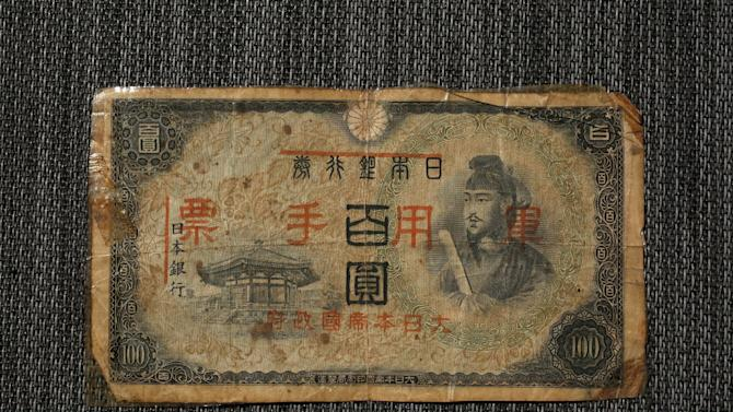 A Japan printed Japanese military 100 yen banknote is seen in this illustration photo in Hong Kong
