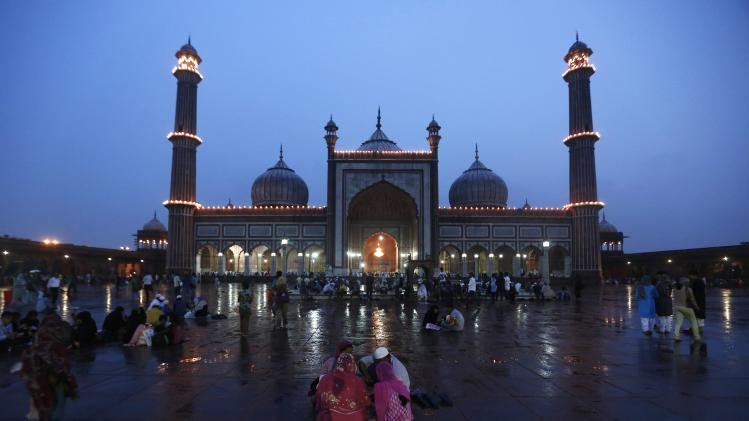 A Muslim family have their iftar meal on the last day of the holy fasting month of Ramadan in India, at the Jama Masjid in the old quarters of Delhi