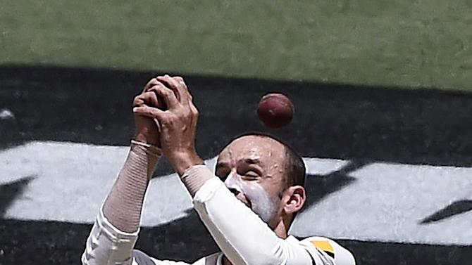 Australia's Nathan Lyon can not catch the ball hit by India's Ajinkya Rahane on the third day of their cricket test match in Melbourne, Australia, Sunday, Dec. 28, 2014. (AP Photo/Andy Brownbill)