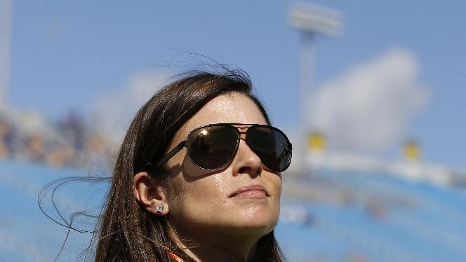 Driver Danica Patrick waits by the pits during during qualifying for the NASCAR Nationwide Series auto race, Saturday, Nov. 17, 2012 at the Homestead-Miami Speedway in Homestead, Fla.  (AP Photo/Terry Renna)