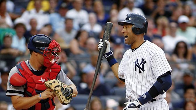 Boston Red Sox's Ryan Lavarnway returns the ball to the pitcher as New York Yankees' Derek Jeter (2) reacts after striking out in the eighth inning of a baseball game, Saturday, Aug. 18, 2012, at Yankee Stadium in New York. The Red Sox beat the Yankees 4-1. (AP Photo/John Dunn)