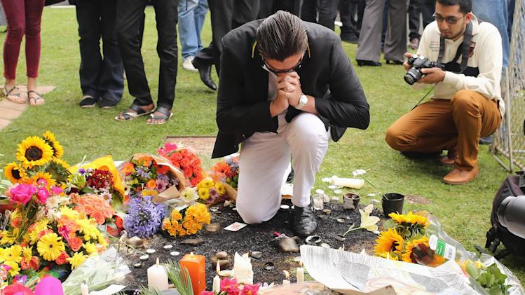 A man pays his respects outside the residence of former South African President Nelson Mandela in Johannesburg