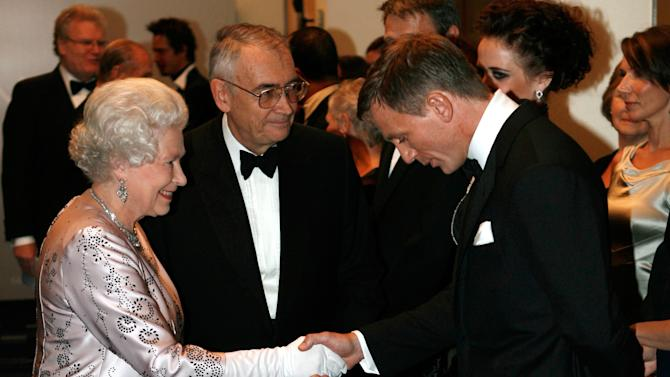 "FILE - In this Nov. 14, 2006 file photo, Britain's Queen Elizabeth II, left, meets actor Daniel Craig, the new James Bond, during the world premiere of the latest James Bond movie ""Casino Royale"" at the Odeon cinema in Leicester Square in London. (AP Photo/Stephen Hird, Pool, File)"