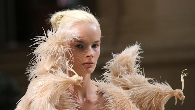 A model wears a creation of Dutch designer Iris van Herpen for the Haute Couture Fall-Winter 2013-2014 collection, Monday, July 1, 2013 in Paris. (AP Photo/Michel Euler)