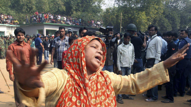 A Bangladeshi woman cries as she arrives to take the body of her relative killed in a fire at a garment factory outside Dhaka, Bangladesh, Sunday, Nov. 25, 2012. At least 112 people were killed in a late Saturday night fire that raced through the multi-story garment factory just outside of Bangladesh's capital, an official said Sunday. (AP Photo/ Jibon Amir)