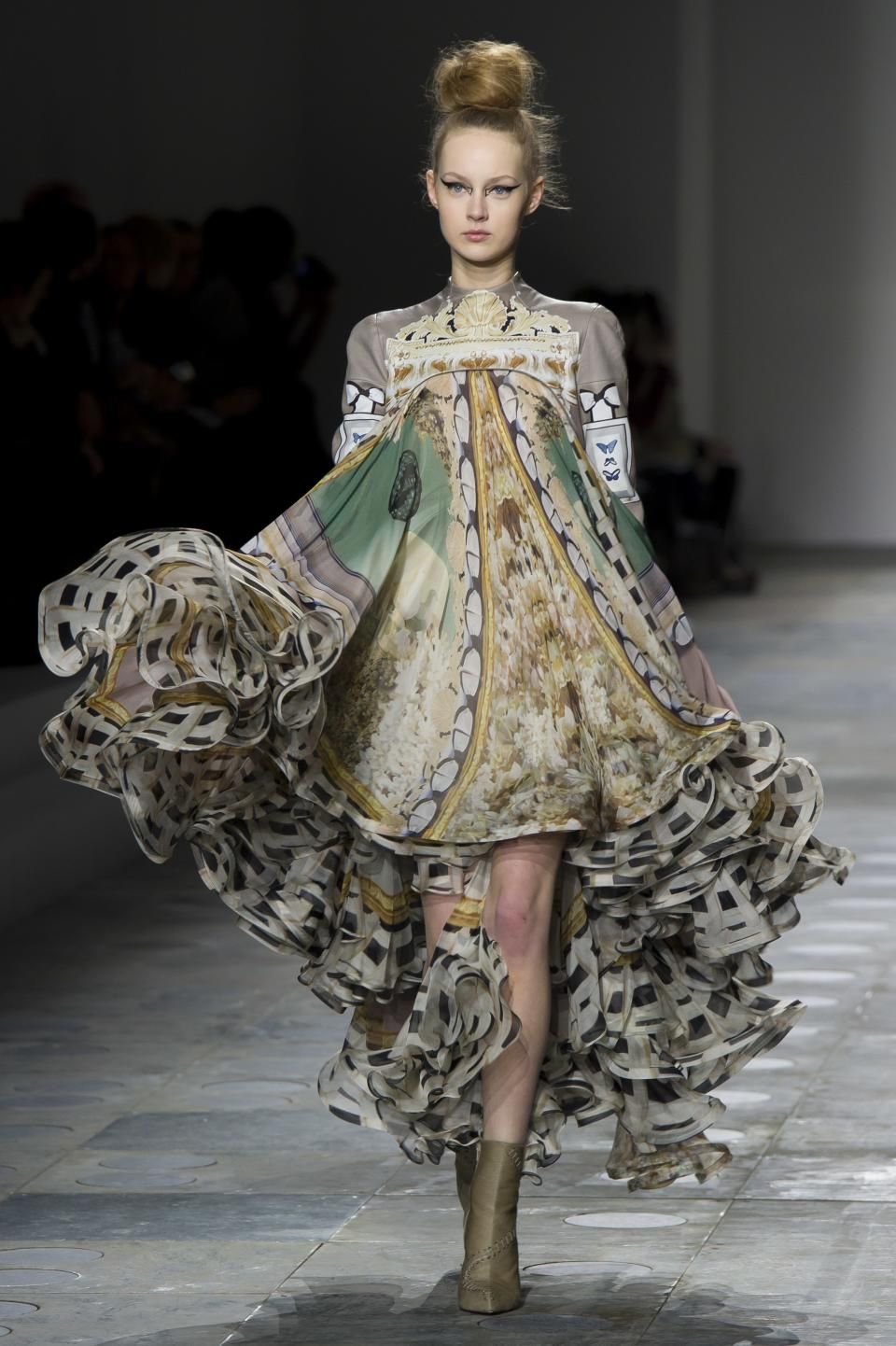 A model displays a creation by designer Mary Katrantzou during a fashion show at London Fashion Week, Tuesday, Feb. 21, 2012. (AP Photo/Jonathan Short)