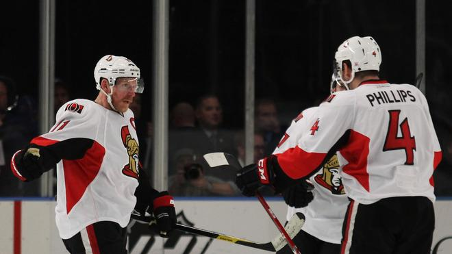Daniel Alfredsson #11 And Chris Phillips #4 Of The Ottawa Senators Celebrate Alfredsson's Goal Getty Images
