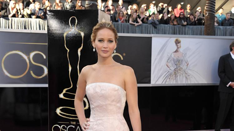 Actress Jennifer Lawrence arrives at the Oscars at the Dolby Theatre on Sunday Feb. 24, 2013, in Los Angeles. (Photo by John Shearer/Invision/AP)