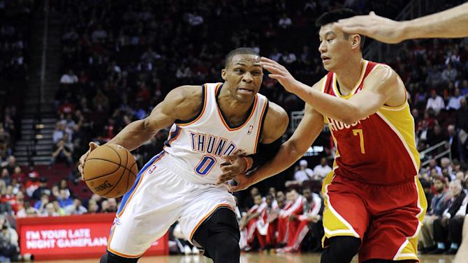 Houston Rockets' Jeremy Lin (7) defends against Oklahoma City Thunder's Russell Westbrook (0) in the first half of an NBA basketball game, Wednesday, Feb. 20, 2013, in Houston. (AP Photo/Pat Sullivan)