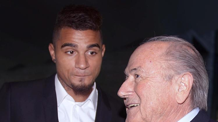 AC Milan's midfielder and Ghana international soccer player Kevin-Prince Boateng, left, meets  FIFA President Joseph S. Blatter, right, at the FIFA headquarters in Zurich, Switzerland, Friday, March 22, 2013. Boateng, who led teammates off the field in protest over racist chants from fans during a friendly match in January, was invited by President Blatter to exchange views on the best way to fight against racism in football. (AP Photo/Keystone, Walter Bieri)