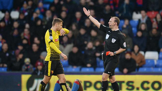 Crystal Palace's Pape Souare is shown a red card by referee Robert Madley after a foul on Watford's Valon Behrami