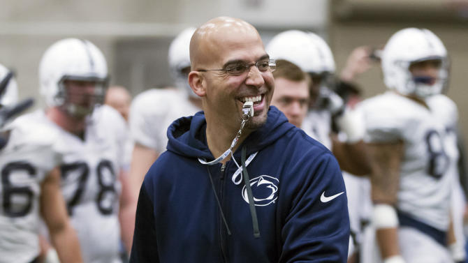 Penn State head coach James Franklin stands during drills at an NCAA college spring football practice Saturday, April 5, 2014, in State College, Pa