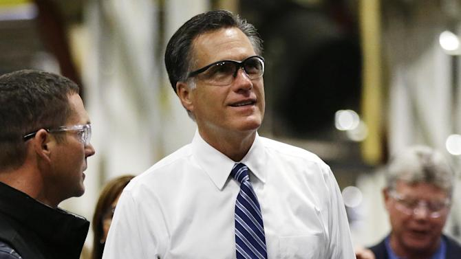 Republican presidential candidate and former Massachusetts Gov. Mitt Romney wears protective glasses as he tours Worthington Industries, a metal processing company, in Worthington, Ohio, Thursday, Oct. 25, 2012. (AP Photo/Charles Dharapak)