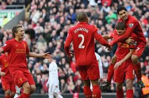 Liverpool captain Gerrard expects Suarez to stay at Anfield next season