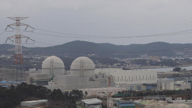 In this Tuesday, Feb. 5, 2013 photo, nuclear power plants, Shin Kori 3, right, and Shin Kori 4 are under construction in Ulsan, South Korea. North Korea's weapons program is not the only nuclear headache for South Korea. The country's radioactive waste storage is filling up as its nuclear power industry burgeons, but what South Korea sees as its best solution  - reprocessing the spent fuel so it can be used again - faces stiff opposition from its U.S. ally. (AP Photo/Ahn Young-joon)