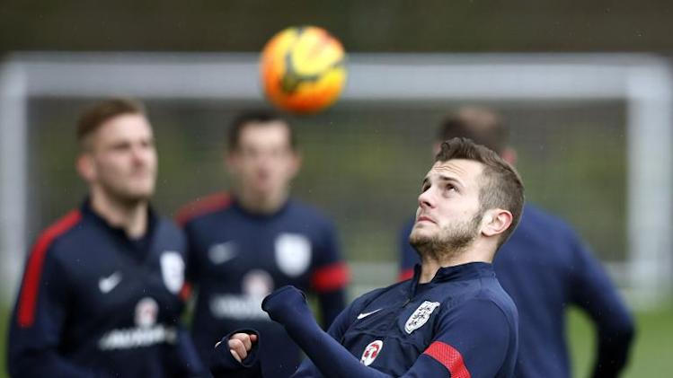 England midfielder Jack Wilshere (R) prepares to head a ball during a training session at Tottenham Hotspur's training complex in Enfield, north London, on March 3, 2014