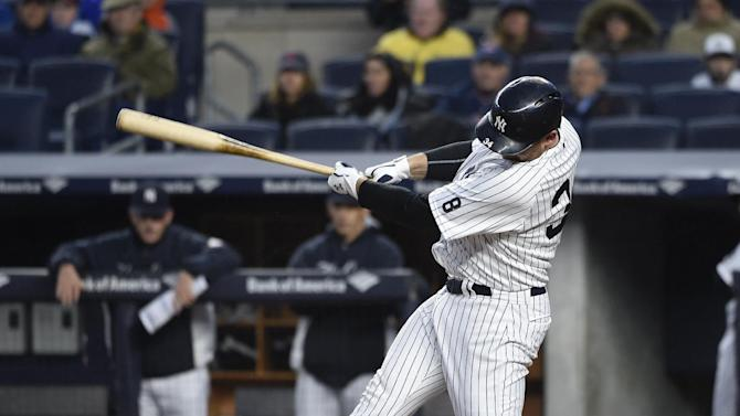 New York Yankees Brian McCann hits an RBI-single off of Boston Red Sox starting pitcher Rick Porcello in the first inning of a baseball game, Friday, May 6, 2016, in New York. (AP Photo/Kathy Kmonicek)