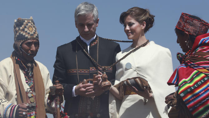 Bolivia's Vice President Alvaro Garcia Linera, left, and his bride Claudia Fernandez are joined by Aymaran spiritual guides during the couple's wedding ceremony at a temple of stone walls in Tiwanaku, Bolivia, Saturday, Sept. 8, 2012. The ceremony uniting the 49-year-old vice president with the 25-year-old journalist was held at an ancestral site constructed by the ancient Aymara people some 3,000 years ago to observe the heavens. (AP Photo/Juan Karita)