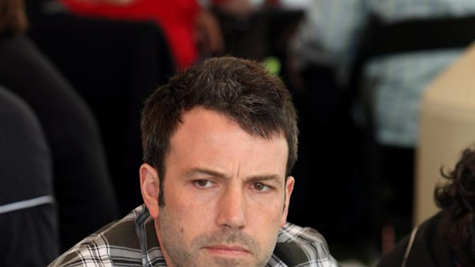 COMMERCIAL IMAGE - In this photograph taken by AP Images for Geffen Playhouse, Ben Affleck plays poker at Playing For Good Benefitting the Geffen Playhouse and Determined to Succeed on Saturday, May 12, 2012 in Santa Monica, Calif. (Casey Rodgers/AP Images for Geffen Playhouse)