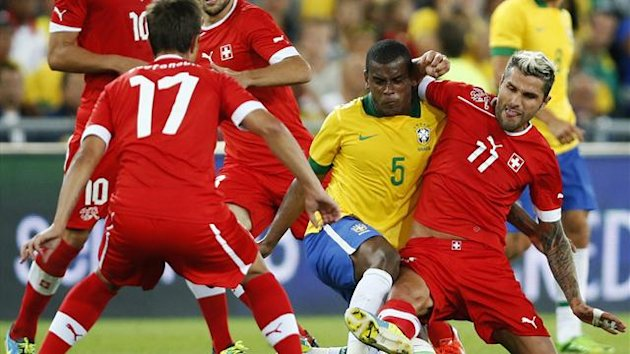 Switzerland's Valon Behrami (R) challenges Brazil's Lucas Fernando (2nd R) during their international friendly soccer match at the St. Jakob-Park stadium in Basel August 14, 2013 (Reuters)