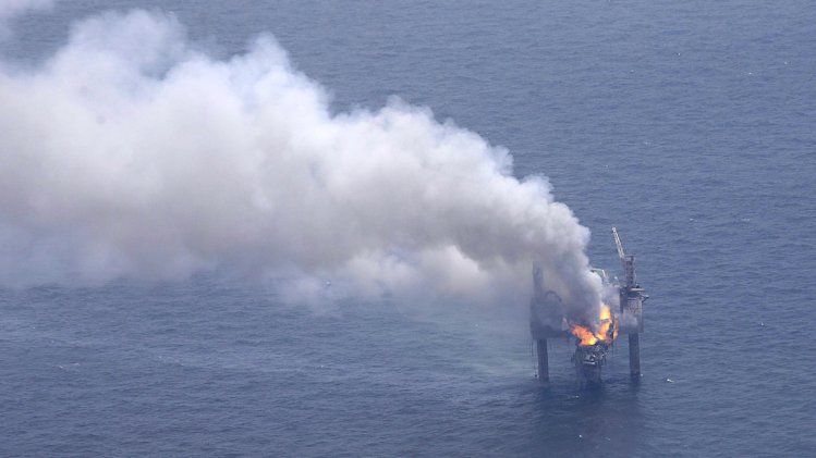 A fire is seen on the Hercules 265 drilling rig in the Gulf of Mexico off the coast of Louisiana, Wednesday, July 24, 2013. Natural gas spewed uncontrolled from the well on Tuesday after a blowout that forced the evacuation of 44 workers aboard the drilling rig, authorities said. No injuries were reported in the blowout. (AP Photo/Gerald Herbert)